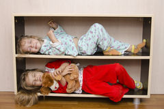 Two of the children to lie on the shelves, bedside tables Royalty Free Stock Photo
