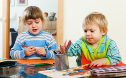 Two children together with pencils Royalty Free Stock Photo