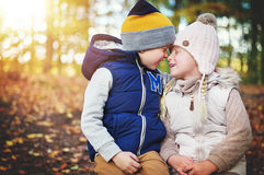 Two children touching each other with noses Stock Images