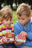 Two children with toy houses in hands outdoor Royalty Free Stock Photography