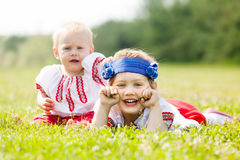 Two children in traditional clothes Royalty Free Stock Image