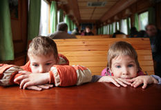 Two children in train Royalty Free Stock Images
