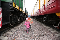Two children between trains Royalty Free Stock Photography