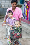 Two children traveling by bicycle stock photo