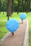 Two children under umbrellas Royalty Free Stock Photo