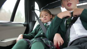 Two Children In Uniform Being Driven To School Royalty Free Stock Photography