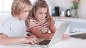 Two children using laptop Royalty Free Stock Image