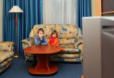 Two children watch tv. In livingroom Royalty Free Stock Photos