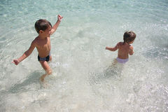 Two children in water Stock Photography