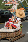 Two children wearing in traditional costumes at Madeira Wine Festival in Estreito de Camara de Lobos, Madeira, Portugal. Stock Photography