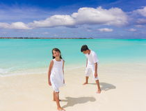 Two children on white sand Royalty Free Stock Photo