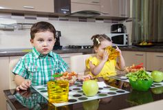 Two children who eat cooked food royalty free stock image