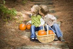 Two Children on Wood Steps with Pumpkins Playing Royalty Free Stock Images