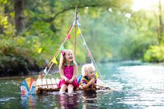 Kids on wooden raft Royalty Free Stock Images