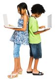 Two children working on laptops. Isolated over white Stock Photos