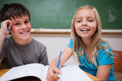 Two children writing Stock Photos