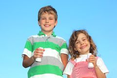 Two children with yoghurt small bottles Royalty Free Stock Photography