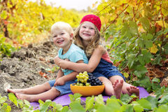 Two childrens are having fun outdoor during autumn Stock Photo