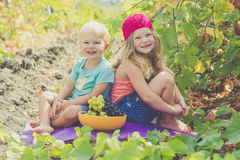 Two childrens are having fun outdoor during autumn Stock Photos