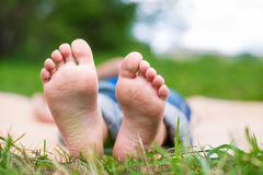 Two Childs foots. Foots of lying child on picnic or yoga. Selective focus royalty free stock photos