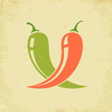 Two chili peppers Stock Photos