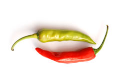 Two chilli peppers Royalty Free Stock Images