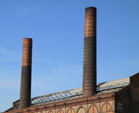 Two chimneys blue sky royalty free stock photography