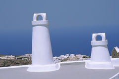 Two chimneys in Santorini Royalty Free Stock Photos