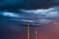 Two chimneys on stormy sky Stock Photography