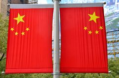 Two China flags on Shanghai lamppost Stock Photo