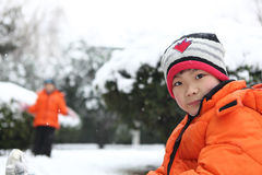 The children play in the snow Stock Image