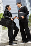 Two Chinese Businessmen Having Discussion Royalty Free Stock Photography