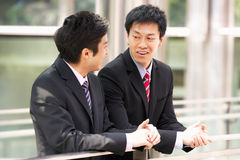 Two Chinese Businessmen Outside Modern Office Stock Photo