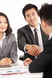 Two Chinese Businessmen Shaking Hands During Meet Royalty Free Stock Image