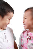 Two chinese children. Two children full of smiles with white background royalty free stock images
