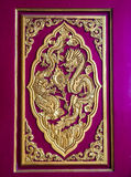 Two Chinese dragons are fighting in the door panel. Two Chinese dragons are fighting in the door panel of Chinese temple in Thailand Stock Photo