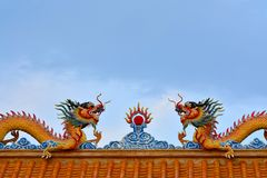 Two Chinese  Dragons status on roof of joss house Stock Photos