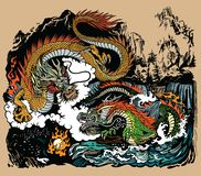 Two Chinese East Asian dragons encircling a flaming pearl royalty free stock image