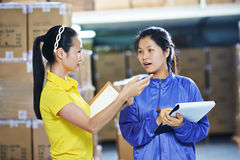 Two chinese female workers in warehouse Royalty Free Stock Image