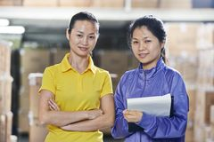 Two chinese female workers in warehouse Royalty Free Stock Photos