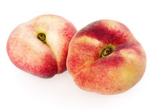 Two chinese flat peaches Royalty Free Stock Images