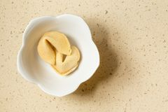 Free Two Chinese Fortune Cookies In A White Bone China Bowl Sitting On A Quartz Countertop Royalty Free Stock Photography - 79185387