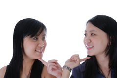 Two chinese girl touching each other Royalty Free Stock Images