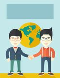 Two chinese guys happily handshaking Stock Photography