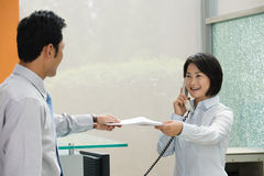 Two Chinese office workers Royalty Free Stock Images