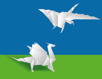 Two Chinese paper dragons. Origami. Two Chinese paper dragons on a green background stock illustration