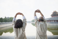 Two Chinese People Exercising Outdoors by the Canal, Beijing Stock Photo