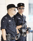 Two Chinese police officers on their post Stock Images