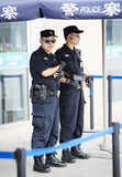 Two Chinese police officers on their post Stock Photo