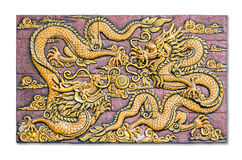 Two Chinese style golden dragons fighting as low relief techniqu Stock Image